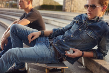 Male fashion shoot witth young models in denim style att the city